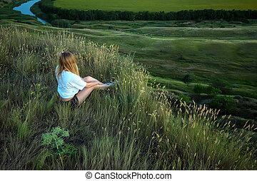 Female hiker sitting on the edge of hill - Beautiful girl...