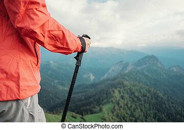 Female hiker trekking outdoor.