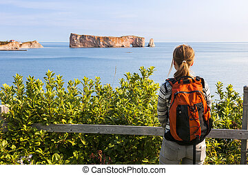 Female hiker viewing Perce Rock