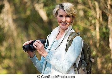 female hiker with binoculars