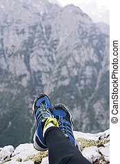 Female hikers shoes at the edge of a cliff