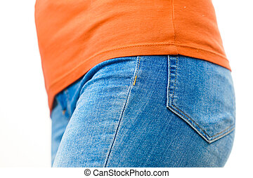 Female hips wearing blue jeans