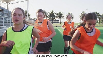 Female hockey players warming up on the field - Front view ...