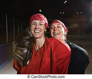 Female hockey players. - Women hockey players in uniform...