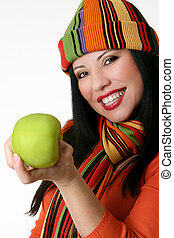 Female holding a fresh green apple