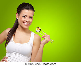 Female Holding A Sushi With Chopstick
