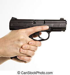 Female holding handgun.