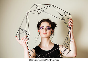 Female holding model of geometric solid