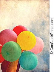Female holding multicolored balloons with blue sky, photo in old image style
