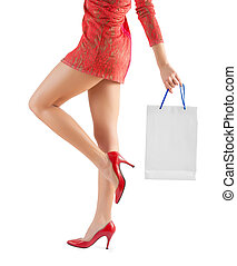 female holding paperbag very close up