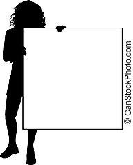Female holding sign