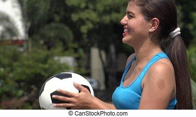 Female Holding Soccer Ball
