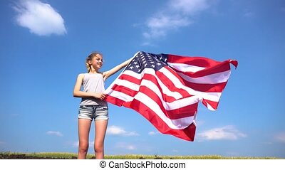 Female holding USA flag in nature - Teen girl in casual...