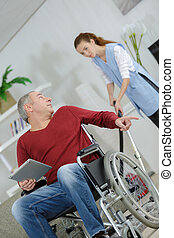female home helper with disabled mature man
