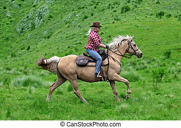 female horse rider - female rider with horse in the outback