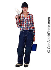 Female housepainter on white background