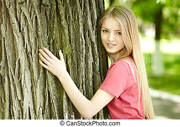 Female hugging a tree