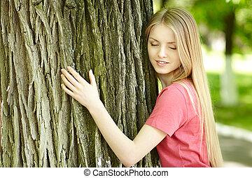 Female hugging a tree