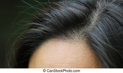Female human hair showing part. - Detail of hair on Asian...