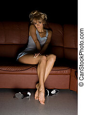 tv - Female in blue lingerie sitting on the sofa and...