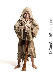 savage woman with gun - female in costume of savage woman ...