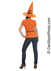 Female in Halloween hat. Rear view