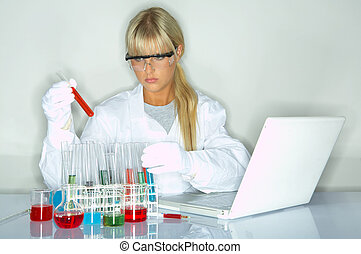Female in lab - Beautifula female lab worker testing and...