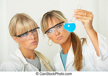 Female in lab - Female lab workers testing and experimenting