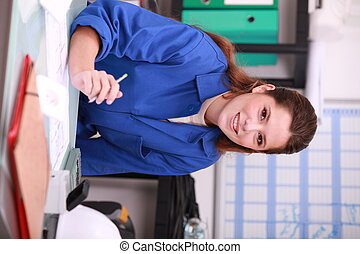 female in plumbing shop
