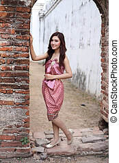 Female in Thai traditional dress at  historical park