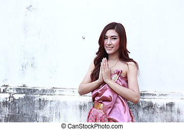 Female in Thai traditional dress - Female pay respect in...