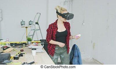 Female in virtual reality headset in workshop - Cute blond...