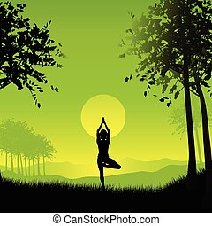 Silhouette of a female in a yoga pose under a sunset sky