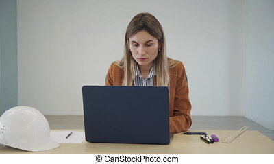 Female Industrial Engineer in the near Hard Hat Uses Laptop ...