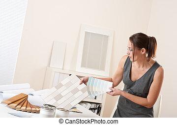 Female interior designer working at office