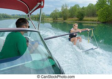 female is exercising waterskiing