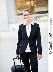 female jetsetter walking in airport