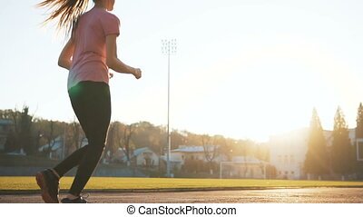 Female Jogger in Stadium