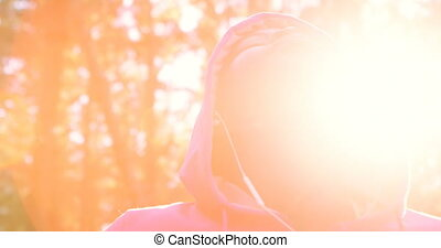 Female jogger with eyes closed standing in the forest 4k -...