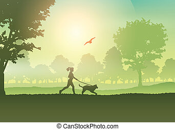 Female jogging with dog in countryside - Silhouette of a ...