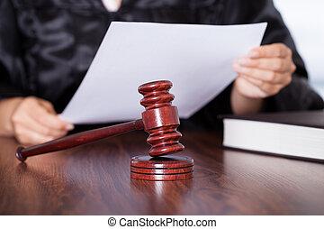 Female Judge Reading Verdict - Close-up Of Female Hands...