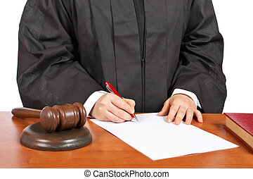 A female judge sign to blank court order, over a white background. Shallow depth of field
