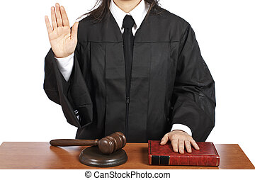 A female judge taking oath in a courtroom, isolated on white background. Shallow depth of field
