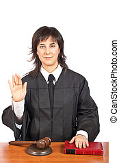Female judge taking oath - A female judge taking oath in a...