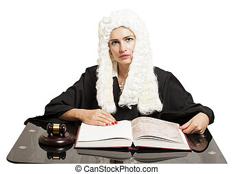 Female judge wearing a wig and black mantle with judge gavel and book