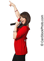 A beautiful female singing into a microphone. Isolated on white background.