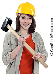 Female labouror holding sledge hammer