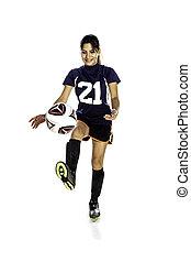 Female Latina Soccer Player KIcking a Ball