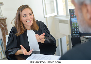 female lawyer and her client