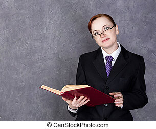 Female lawyer holding a big book with serious expression,...